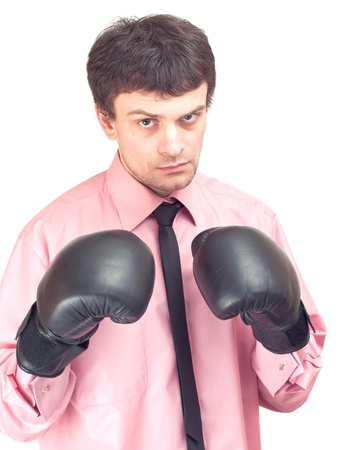 Businessman with boxing gloves. Concept: competition, aggressiveness. Stock Photo - 9741611