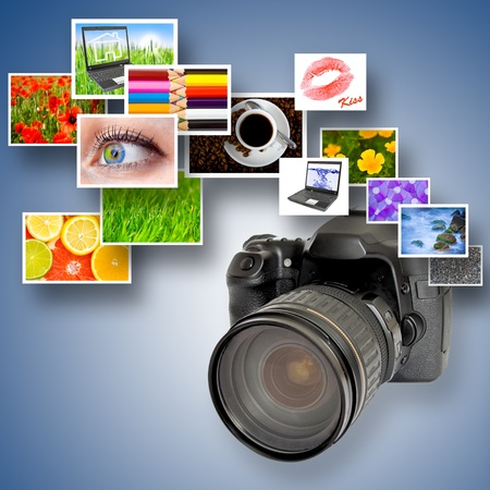 Digital camera and photographs against blue background photo