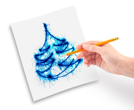 Womanish hand with a pencil in his hand draws a Christmas tree. photo