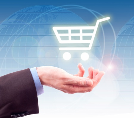 hand holding a shopping cart Stock Photo - 9700754