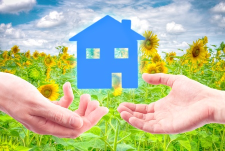 From hand to hand the house as a symbol of real estate business. Stock Photo - 9700732