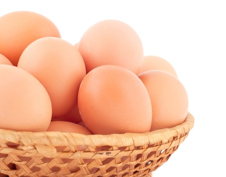 Fresh brown eggs on white background. photo