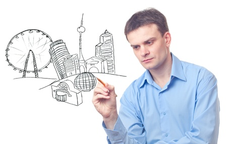 Businessman drawing a city on white background Stock Photo - 9741623