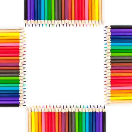 Colored pencils  on  a white background in a  frame photo