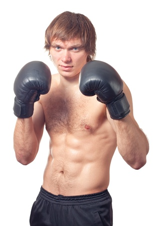 tough: Young caucasian man boxer with black boxing gloves on white background. Studio shot. Stock Photo
