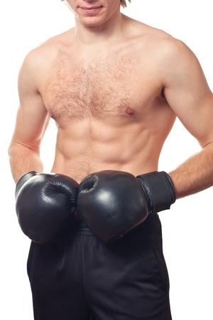 pugilist: Man boxer with black boxing gloves on white background. Studio shot.