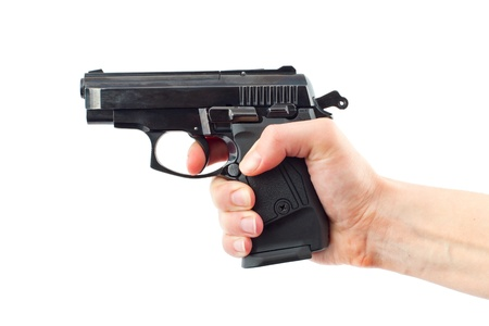 Hand with gun on white. Isolated Stock Photo - 9701738