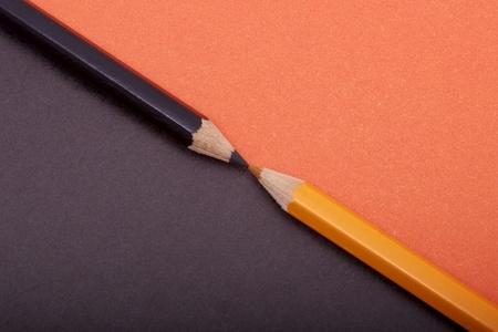 diagonally: Two colored pencils diagonally