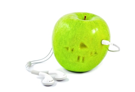 green apple in which headphones are connected Stock Photo - 9701895