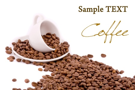 Coffee cup and grain on white background photo