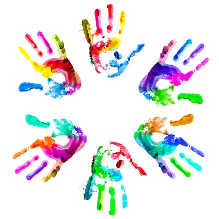 cultural: Multi coloured painted handprints arranged in a circle on a white background. Stock Photo