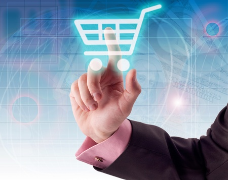 Man hand pressing shopping cart icon photo