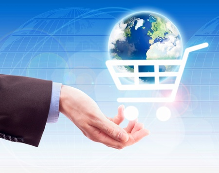 Hand holding a shopping cart with earth. Internet shopping concept Stock Photo - 9700647