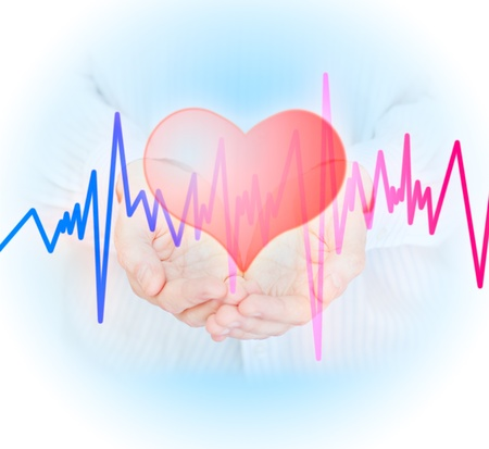Hands, heart  and  pulse. Health insurance concept. photo