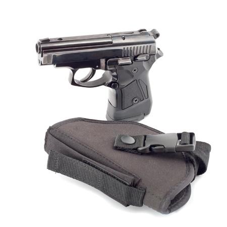holster: El stand de pistola autom�tica sobre el color de la funda negra. Foto de archivo