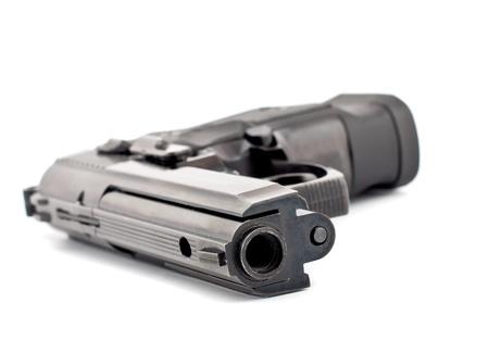 Black lying pistol isolated on white Stock Photo - 9700298