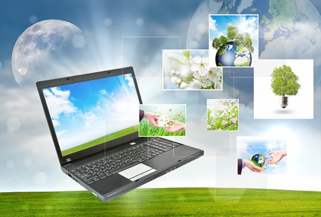 Colorful collage of laptop against green nature background Stock Photo