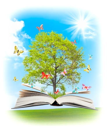 turning page: Magic book with a green tree and the rays of light on the background of nature. Symbol of knowledge.