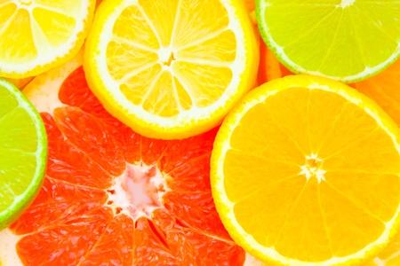 Mixed citrus fruit. Orange, grapefruit, lemon, lime photo