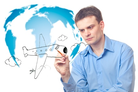 Businessman drawing a plane on a world map background. Isolated on white photo