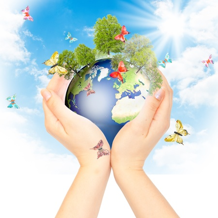 protection of land: Hands and Earth. Concept Save green planet. Symbol of environmental protection.