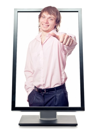 man's thumb: Mans hand with thumb up come out from a screen of a monitor computer. Isolated on white background. Symbol of success concept Stock Photo