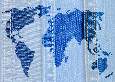 World map of jeans on jeans background photo