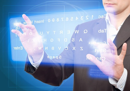 Hands pushing a button on a touch screen. Virtual Keyboard.