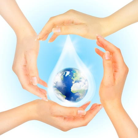 tsunamis: Drop of water with Earth inside and hands on white . The symbol of Save Planet. Floods, tsunamis, natural disasters. Stock Photo
