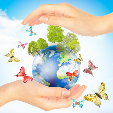 Hands and Earth. Concept Save green planet. Symbol of environmental protection. Stock Photo - 9698436