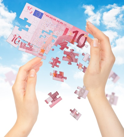Hands and puzzle out of the money EURO. The concept of a crisis Stock Photo - 9837142