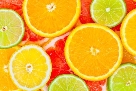 Mixed citrus fruit background photo