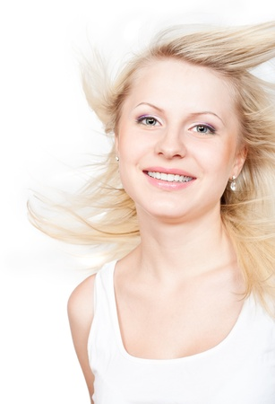 Beautiful blonde with a flying hair. Isolated on white background photo