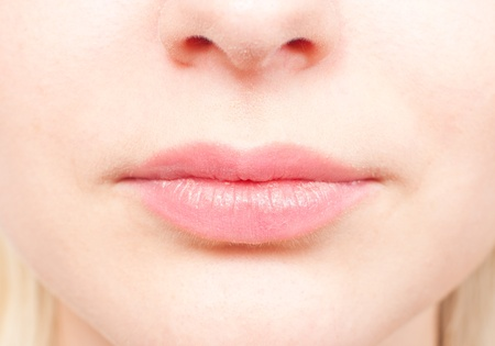Close-up details of a womans face - the nose and mouth