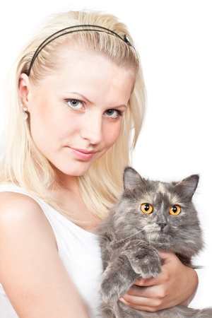 holding the head: Happy young blonde girl and grey cat. Isolated on white background Stock Photo