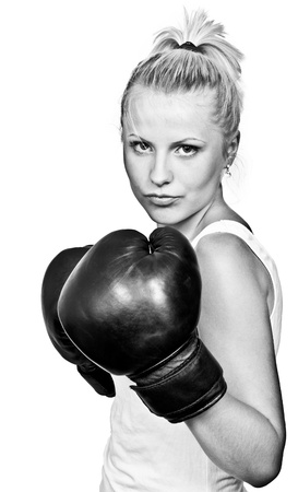 kickboxing: Beautiful blonde girl in boxing gloves. Isolated on white background