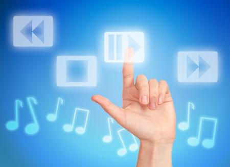 Hand pressing button play and musical notes Stock Photo - 10032565