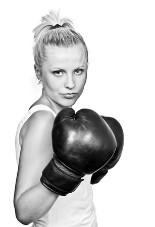 Beautiful blonde girl in boxing gloves. Isolated on white background photo