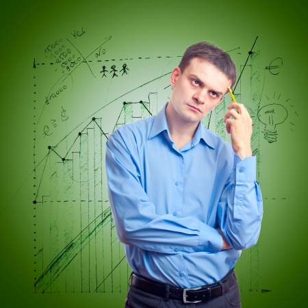 Young businessman in thinking on the background of the chart Stock Photo - 10129237