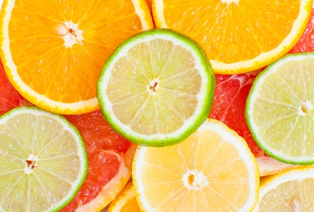 Mixed citrus fruit background. Food and diet photo