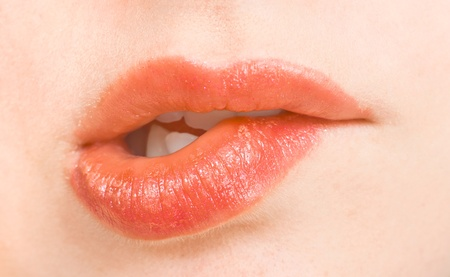 Close-up bite your lip red photo