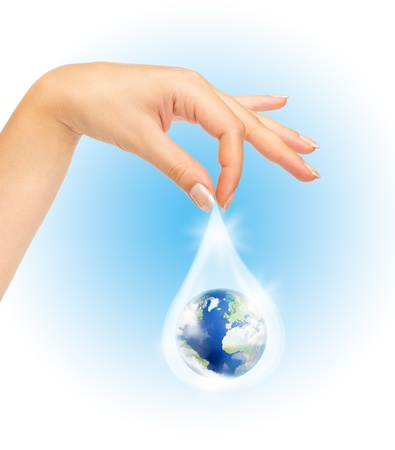 Drop of water with Earth inside and hand. The symbol of Save Planet photo