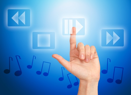 Hand pressing button play and musical notes Stock Photo - 10503620