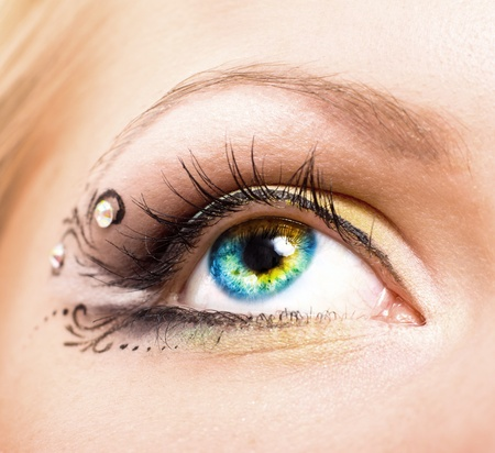 close up eye: Close up Colourful human eye with makeup. Beauty and fashion Stock Photo