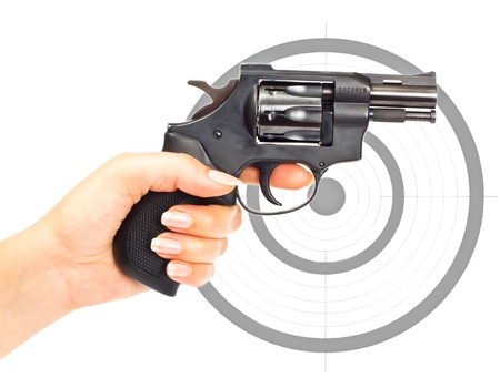 Hand with gun and target isolated over a white background photo