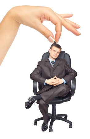 Businessman sitting on chair and woman's hand. Isolated on white background Stock Photo - 10635365