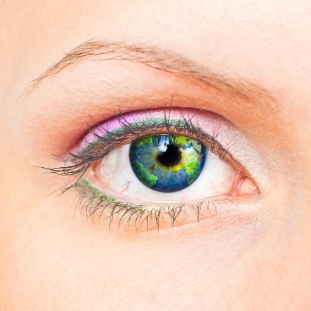 colour images: Close-up of beauty female eye with Earth inside