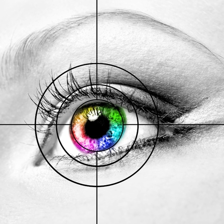 Close-up of colourful human eye and target photo