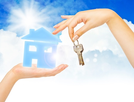 Concept of buying house on blue sky background Stock Photo - 10635383