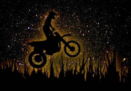 MX Rider silhouette on night sky photo